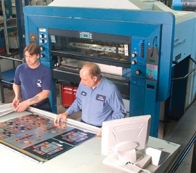 men working at package printing